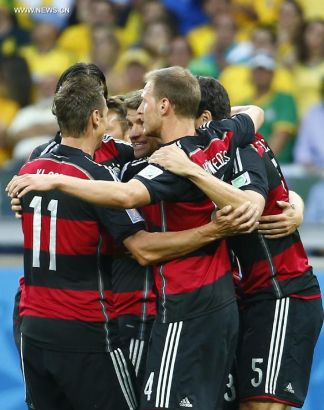 Germany's players celebrate a goal during a semifinal match between Brazil and Germany of 2014 FIFA World Cup at the Estadio Mineirao Stadium in Belo Horizonte, Brazil, on July 8, 2014.(Xinhua/Chen Jianli)