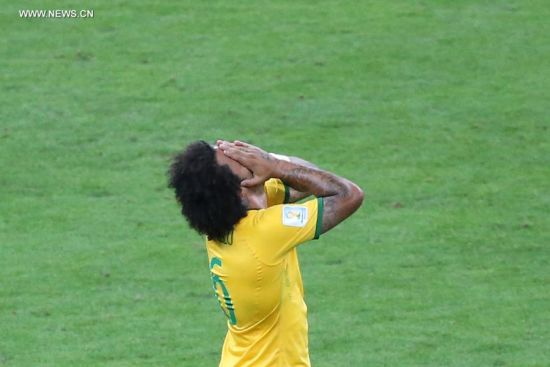 Brazil's Marcelo reacts during a semifinal match between Brazil and Germany of 2014 FIFA World Cup at the Estadio Mineirao Stadium in Belo Horizonte, Brazil, on July 8, 2014.(Xinhua/Li Ming)