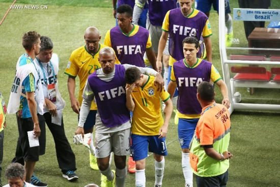 Brazil's players leave the field after a semifinal match between Brazil and Germany of 2014 FIFA World Cup at the Estadio Mineirao Stadium in Belo Horizonte, Brazil, on July 8, 2014. Germany won 7-1 over Brazil and qualified for the final on Tuesday.(Xinhua/Li Ming)
