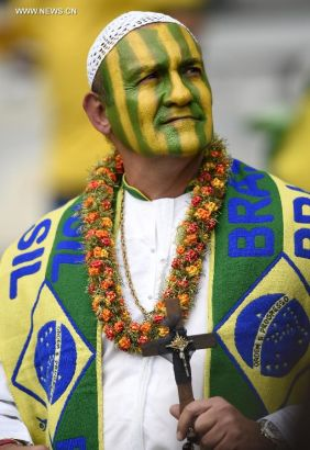 A Brazil's supporter looks on during a semifinal match between Brazil and Germany of 2014 FIFA World Cup at the Estadio Mineirao Stadium in Belo Horizonte, Brazil, on July 8, 2014. Germany won 7-1 over Brazil and qualified for the final on Tuesday. (Xinhua/Qi Heng)
