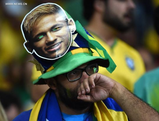 A Brazil's fan reacts while watching a semifinal match between Brazil and Germany of 2014 FIFA World Cup at the Estadio Mineirao Stadium in Belo Horizonte, Brazil, on July 8, 2014. Germany won 7-1 over Brazil and qualified for the final on Tuesday.(Xinhua/Li Ga)
