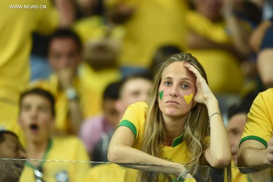 A Brazil's supporter looks on during a semifinal match between Brazil and Germany of 2014 FIFA World Cup at the Estadio Mineirao Stadium in Belo Horizonte, Brazil, on July 8, 2014.(Xinhua/Liu Dawei)