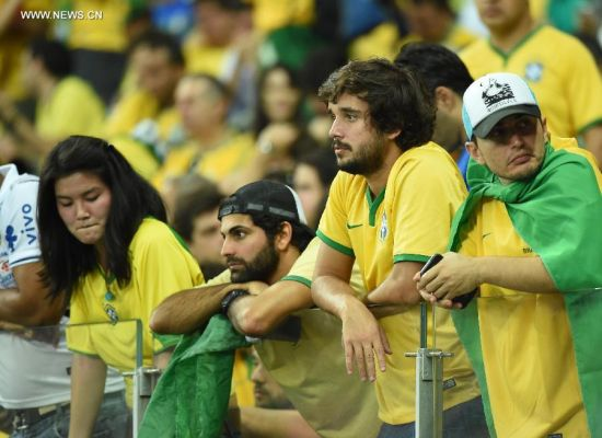 Brazil's supporters look on during a semifinal match between Brazil and Germany of 2014 FIFA World Cup at the Estadio Mineirao Stadium in Belo Horizonte, Brazil, on July 8, 2014.(Xinhua/Liu Dawei)