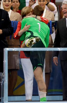 German Chancellor Angela Merkel hugs Germany's goalkeeper Manuel Neuer following their 1-0 victory over Argentina after the World Cup final soccer match between Germany and Argentina at the Maracana Stadium in Rio de Janeiro, Brazil, Sunday, July 13, 2014.
