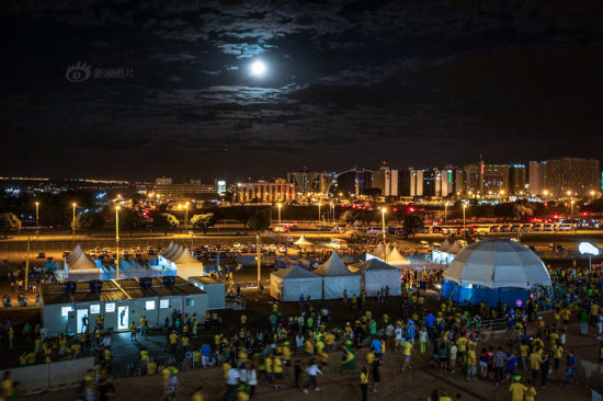 Football fans left the stadium later at 7 pm, distressed with Brazil's 0:3 defeat by Holland.
