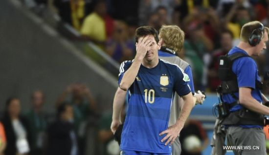 Argentina's Lionel Messi reacts after the final match between Germany and Argentina of 2014 FIFA World Cup at the Estadio do Maracana Stadium in Rio de Janeiro, Brazil, on July 13, 2014. Germany won 1-0 over Argentina after 120 minutes and took its fourth World Cup title on Sunday. (Xinhua/Yang Lei)(pcy)