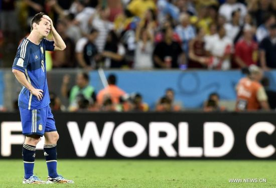 Argentina's Lionel Messi reacts after the final match between Germany and Argentina of 2014 FIFA World Cup at the Estadio do Maracana Stadium in Rio de Janeiro, Brazil, on July 13, 2014. Germany won 1-0 over Argentina after 120 minutes and took its fourth World Cup title on Sunday. (Xinhua/Qi Heng)(pcy)