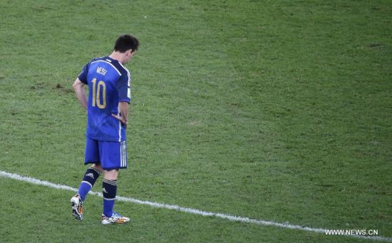 Argentina's Lionel Messi reacts after the final match between Germany and Argentina of 2014 FIFA World Cup at the Estadio do Maracana Stadium in Rio de Janeiro, Brazil, on July 13, 2014. Germany won 1-0 over Argentina after 120 minutes and took its fourth World Cup title on Sunday. (Xinhua/Liao Yujie)