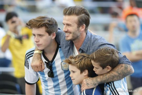 David Beckham poses with his sons before the final match between Germany and Argentina of 2014 FIFA World Cup at the Estadio do Maracana Stadium in Rio de Janeiro, Brazil, on July 13, 2014. Germany won 1-0 over Argentina after 120 minutes and took its fourth World Cup title on Sunday. (Xinhua/Liao Yujie)