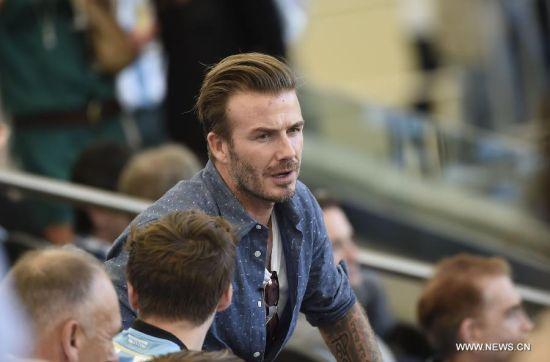 Former England footballer David Beckham is seen before the final match between Germany and Argentina of 2014 FIFA World Cup at the Estadio do Maracana Stadium in Rio de Janeiro, Brazil, on July 13, 2014. (Xinhua/Lui Siu Wai)