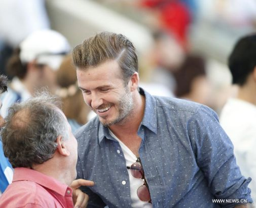 Former England footballer David Beckham is seen before the final match between Germany and Argentina of 2014 FIFA World Cup at the Estadio do Maracana Stadium in Rio de Janeiro, Brazil, on July 13, 2014. (Xinhua/Liao Yujie)