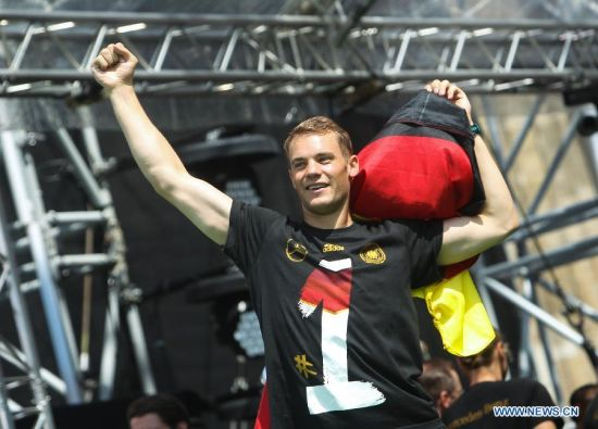 German football player Manuel Neuer waves his fist during celebration to mark the team's 2014 Brazil World Cup victory in Berlin, Germany, July 15, 2014. Germany's team returned home on Tuesday after winning the 2014 Brazil World Cup. (Xinhua/Zhang Fan)