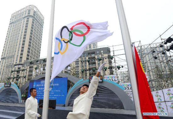 The olympic flag is raised during the opening ceremony of the Youth Olympic village ahead of the Youth Olympic Games in Nanjing, capital of east China's Jiangsu Province, Aug, 12, 2014. The Nanjing 2014 Youth Olympic games will be held from August 16 to 28. (Xinhua/Cheng Min)