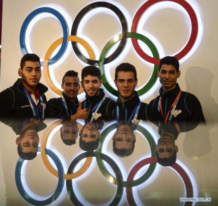 Athletes of Tunisia pose for photo at the Youth Olympic Village in Nanjing, east China's Jiangsu Province, August 14, 2014. Nanjing 2014 Youth Olympic Games will be held from August 16 to 28. (Xinhua/Purbu Zhaxi)