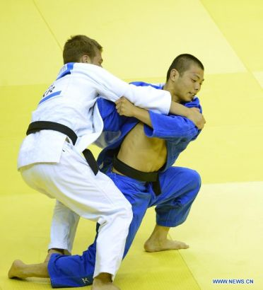 Abe Hifumi of Japan(L) competes with Bogdan Iadov of Ukraine during Men -66 kg of Judo event of Nanjing 2014 Youth Olympic Games in Nanjing, capital of east China's Jiangsu Province, August 17, 2014. Abe Hifumi won the gold medal. (Xinhua/Yang Shiyao)