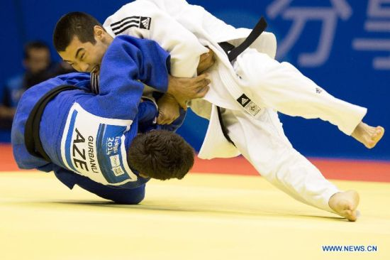 Bauyrzhan Zhauyntayev of Kazakhstan(Top) competes with Natig Gurbanli of Azerbaijan during Men -55 kg of Judo event of Nanjing 2014 Youth Olympic Games in Nanjing, capital of east China's Jiangsu Province, August 17, 2014. Bauyrzhan Zhauyntayev won the gold medal. (Xinhua/Guo Chen)