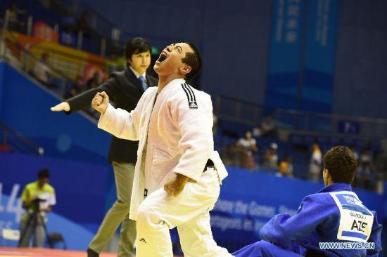 Bauyrzhan Zhauyntayev of Kazakhstan celebrates after Men -55 kg of Judo event of Nanjing 2014 Youth Olympic Games in Nanjing, capital of east China's Jiangsu Province, August 17, 2014. Bauyrzhan Zhauyntayev won the gold medal. (Xinhua/Jiang Kehong)
