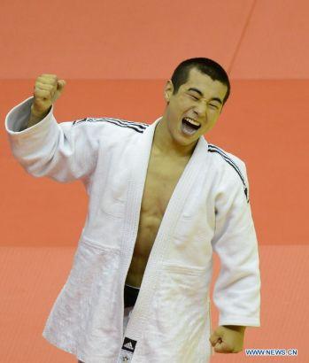 Bauyrzhan Zhauyntayev of Kazakhstan celebrates after Men -55 kg of Judo event of Nanjing 2014 Youth Olympic Games in Nanjing, capital of east China's Jiangsu Province, August 17, 2014. Bauyrzhan Zhauyntayev won the gold medal. (Xinhua/Yang Shiyao)