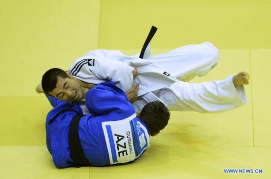 Bauyrzhan Zhauyntayev(Top) of Kazakhstan competes with Natig Gurbanli of Azerbaijan during Men -55 kg of Judo event of Nanjing 2014 Youth Olympic Games in Nanjing, capital of east China's Jiangsu Province, August 17, 2014. Bauyrzhan Zhauyntayev won the gold medal. (Xinhua/Yang Shiyao)