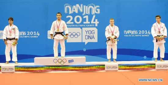 Bauyrzhan Zhauyntayev of Kazakhstan(2nd, L), Natig Gurbanli of Azerbaijan(1st, L), Jorre Verstraeten of Belgium(2nd, R) and Oguzhan Karaca of Turkey pose after Men -55 kg of Judo event of Nanjing 2014 Youth Olympic Games in Nanjing, capital of east China's Jiangsu Province, August 17, 2014. Bauyrzhan Zhauyntayev won the gold medal. (Xinhua/Guo Chen)