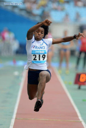 Gold Medalist Yanis Esmeralda David of France competes in the Women's Triple Jump Final of athletics event at the Nanjing 2014 Youth Olympic Games in Nanjing, capital of east China's Jiangsu Province, Aug. 25, 2014. (Xinhua/Zhang Hongxiang)