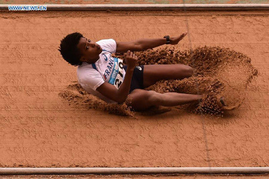 Gold Medalist Yanis Esmeralda David of France competes in the Women's Triple Jump of athletics event at the Nanjing 2014 Youth Olympic Games in Nanjing, capital of east China's Jiangsu Province, Aug. 25, 2014. (Xinhua/Ou Dongqu)