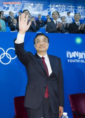 Chinese Premier Li Keqiang attends the closing ceremony of the second Summer Youth Olympic Games, in Nanjing, capital of east China's Jiangsu Province, Aug. 28, 2014. (Xinhua/Xie Huanchi)
