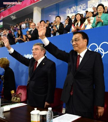 Chinese Premier Li Keqiang (R front) attends the closing ceremony of the second Summer Youth Olympic Games, in Nanjing, capital of east China's Jiangsu Province, Aug. 28, 2014. (Xinhua/Ma Zhancheng)