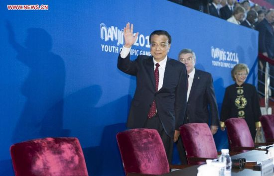 Chinese Premier Li Keqiang (front) attends the closing ceremony of the second Summer Youth Olympic Games, in Nanjing, capital of east China's Jiangsu Province, Aug. 28, 2014. (Xinhua/Xie Huanchi)