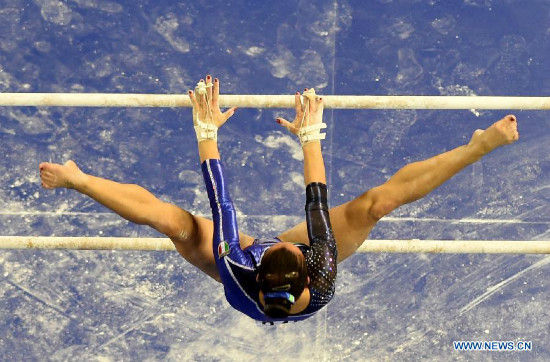 Italian gymnast Vanessa Ferrari performs on the uneven bars during the women's team final of the 45th Gymnastics World Championships in Nanning, capital of south China's Guangxi Zhuang Autonomous Region, Oct. 8, 2014. (Xinhua/Wang Yuguo)