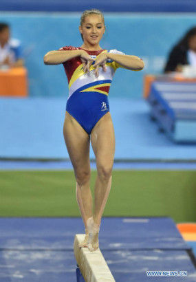 Romanian gymnast Larisa Andreea Iordache performs on the beam during the women's team final of the 45th Gymnastics World Championships in Nanning, capital of south China's Guangxi Zhuang Autonomous Region, Oct. 8, 2014. Romania ranked fourth in the final.(Xinhua/Liu Jun)