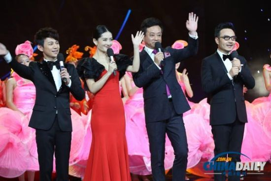 (L-R) Chinese TV hosts He Jiong, Xie Na, Zhu Jun and Wang Han perform at the opening ceremony of the 10th China Golden Eagle TV Art Festival in Changsha, Hunan province on Oct 10, 2014.