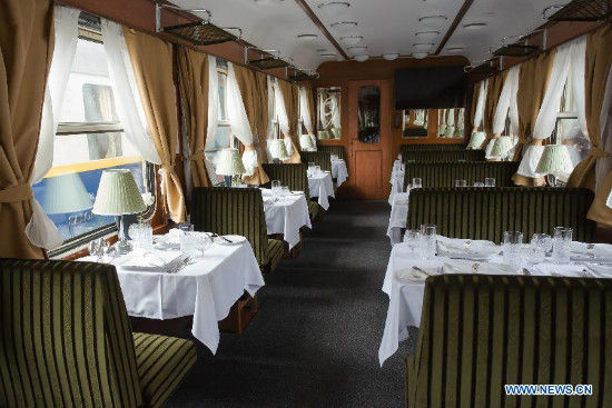 A dining car of the Golden Eagle Danube Express luxury train is seen at the Western Railway Station in Budapest, Hungary, Oct. 15, 2014. Golden Eagle Danube Express pulled out of Budapest's Western Railway Station on Oct. 15, kicking off a 13-day 7,000-kilometer journey to Teheran, Iran. The fare is 10,000 to 15,000 U.S. dollars. The train is made up of 13 revamped old luxury cars, all of which are museum pieces. It travels through Romania and Bulgaria to Turkey, where the entire train will be loaded onto a ferry crossing to Izmit, on Turkey's Asian side. From there it will roll on into Iran on its own wheels, ending its journey in Tehran. (Xinhua/Attila Volgyi)
