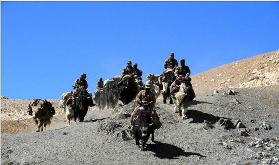 """Chinese soldiers ride yaks and patrol border between China and Pakistan. The border features the Khunjerab Pass, which is the highest paved international border crossing in the world and the highest point on the Karakoram Highway. In Persian, Khunjerab means """"valley of death"""" because of its extreme climate. [Photo/ Weibo account of PLA Daily]"""