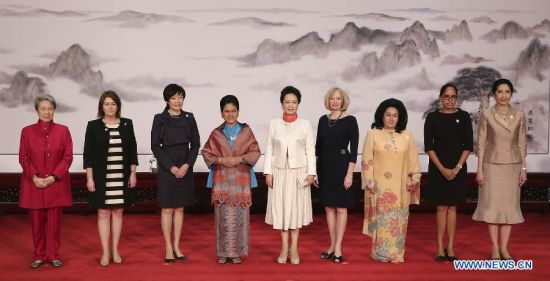 Peng Liyuan (C), wife of Chinese President Xi Jinping, poses for a group photo with Ho Ching (1st L), wife of Singapore's Prime Minister Lee Hsien Loong, Bronagh Key (2nd L), wife of New Zealand's Prime Minister John Key, Akie Abe (3rd L), wife of Japanese prime minister Shinzo Abe, Iriana Widodo (4th L), wife of Indonesian President Joko Widodo, Laureen Harper (4th R), wife of Canada's Prime Minister Stephen Harper, Rosmah Mansor (3rd R), wife of Malaysia's Prime Minister Najib Razak, Lynda Babao (2nd R), wife of Papua New Guinea Prime Minister Peter O'Neill, and Naraporn Chan-ocha (1st R), wife of Thailand's Prime Minister Prayuth Chan-ocha, during an activity focusing on development issues concerning disabled people, in Beijing, China, Nov. 10, 2014. Peng Liyuan (C), wife of Chinese President Xi Jinping, poses for a group photo with Ho Ching (1st L), wife of Singapore's Prime Minister Lee Hsien Loong, Bronagh Key (2nd L), wife of New Zealand's Prime Minister John Key, Akie Abe (3rd L), wife of Japanese prime minister Shinzo Abe, Iriana Widodo (4th L), wife of Indonesian President Joko Widodo, Laureen Harper (4th R), wife of Canada's Prime Minister Stephen Harper, Rosmah Mansor (3rd R), wife of Malaysia's Prime Minister Najib Razak, Lynda Babao (2nd R), wife of Papua New Guinea Prime Minister Peter O'Neill, and Naraporn Chan-ocha (1st R), wife of Thailand's Prime Minister Prayuth Chan-ocha, during an activity focusing on development issues concerning disabled people, in Beijing, China, Nov. 10, 2014.(Xinhua/Huang Jingwen)