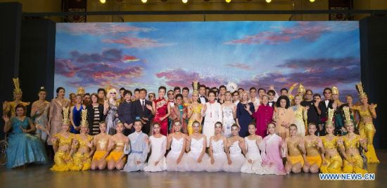 Peng Liyuan (C), wife of Chinese President Xi Jinping, poses for a group photo with disabled performers after watching their performance together with spouses of some leaders of the Asia-Pacific Economic Cooperation (APEC) member economies after a meeting focusing on development issues concerning disabled people in Beijing, China, Nov. 10, 2014. (Xinhua/Ding Lin)
