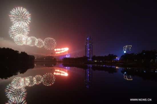 Fireworks explode over the Olympic Park in Beijing, China, Nov. 10, 2014. The 22nd Asia-Pacific Economic Cooperation (APEC) Economic Leaders' Meeting takes place in Beijing from Nov. 10 to 11. (Xinhua/Wang Shen)