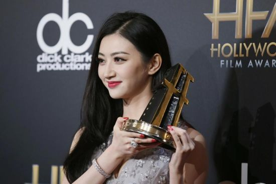 Actress Jing Tian poses backstage with her International Award at the Hollywood Film Awards in Hollywood, California November 14, 2014.