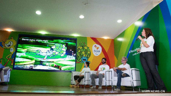 Rio 2016 Brand Director Beth Lula (1st, R) gives an introduction of the design of the mascots in Rio de Janeiro, Brazil, Nov. 24, 2014. The unveiling ceremony of the mascots was held here on Monday. The mascot Rio 2016 Olympic and Paralympic was originated from the animals and plants in Brazil respectively. A poll to decide their names will be opened after the unveiling of the two mascots. (Xinhua/Xu Zijian)