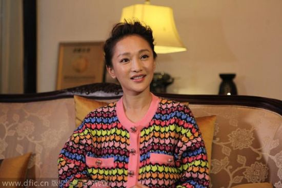Chinese actress Zhou Xun, chairwoman of the panel of judges for the 2nd Zhejiang Youth Film Festival, listens to a question during an interview ahead of the award ceremony of the festival in Hangzhou city, east China's Zhejiang province, Nov 11, 2014.