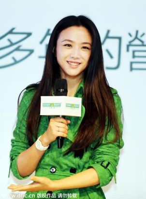 Chinese actress Tang Wei smiles during a promotional event for Natures Bounty in Hong Kong, China, 27 June 2014.