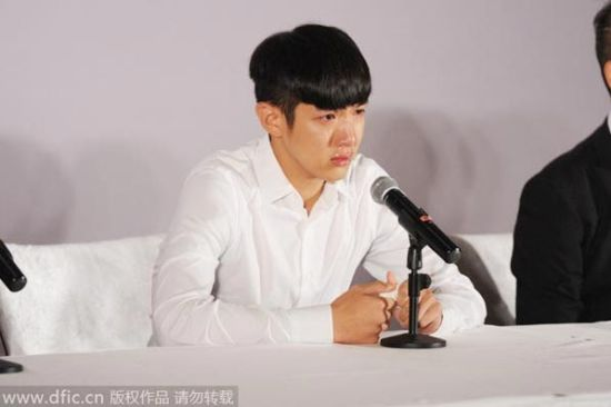 Taiwan-based Chinese actor Kai Ko reacts during a press conference in Beijing on August 29, 2014.
