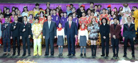 Chinese President Xi Jinping (6th R, front) sings