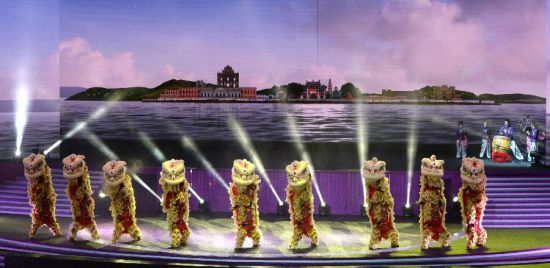 Performers stage a lion dance during an evening gala marking the 15th anniversary of Macao's return to the motherland in south China's Macao, Dec. 19, 2014. (Xinhua/Qin Qing)