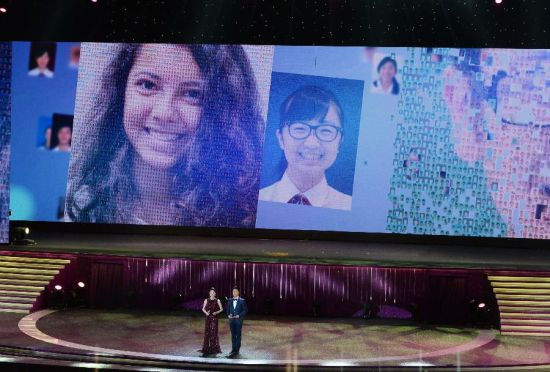 Two hosts are seen during an evening gala marking the 15th anniversary of Macao's return to the motherland in south China's Macao, Dec. 19, 2014. (Xinhua/Qin Qing)