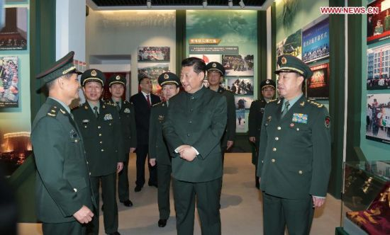 Chinese President Xi Jinping, also general secretary of the Central Committee of the Communist Party of China and chairman of the Central Military Commission, visits a history museum of the Chinese People's Liberation Army Garrison in the Macao Special Administrative Region (SAR) in Macao, south China, Dec. 20, 2014. (Xinhua/Li Gang)