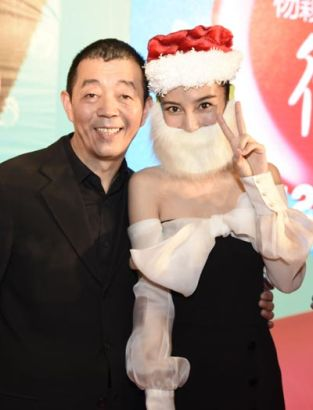 Director Gu Changwei (left) and actress Angelababy appear at an event to promote Love on the Clouds in Beijing.