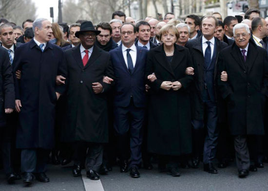 French President Francois Hollande is surrounded by head of states including (L to R) Israel's Prime Minister Benjamin Netanyahu, Mali's President Ibrahim Boubacar Keita, Germany's Chancellor Angela Merkel, European Council President Donald Tusk and Palestinian President Mahmoud Abbas as they attend the solidarity march (Marche Republicaine) in the streets of Paris, January 11, 2015. [Photo/Agencies]