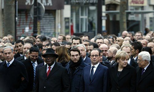 French President Francois Hollande, German Chancellor Angela Merkel and Palestinian President Mahmud Abbas take part in the Unity March in Paris on Sunday. Photos: AFP
