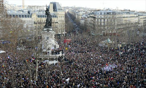 People gather on the Place de la Republique (Republic Square) in Paris before the start of the Unity March on Sunday in tribute to the 17 victims of a three-day killing spree by homegrown Islamists. Photos: AFP